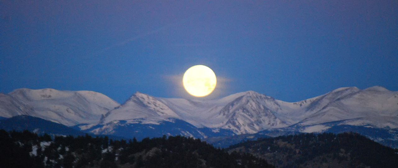 Moon over the Rockies by Jon Shore © All rights reserved